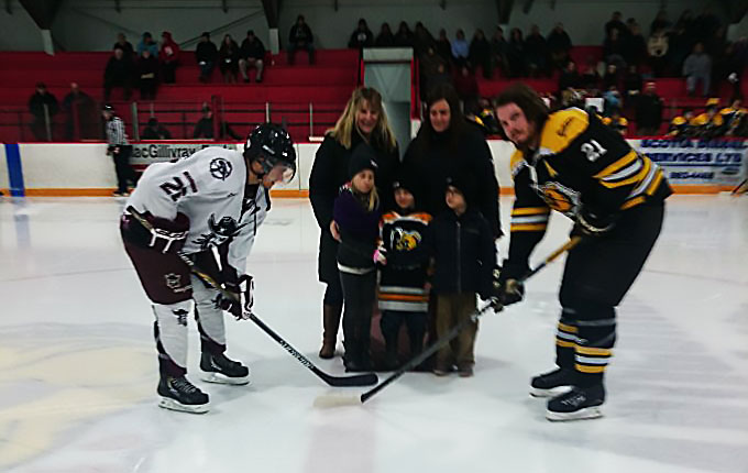 "Farmers' Mutual Insurance ""family"" drops the puck at ceremonial face-off"